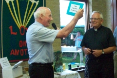 Canon Michael presenting a gift form the parishes