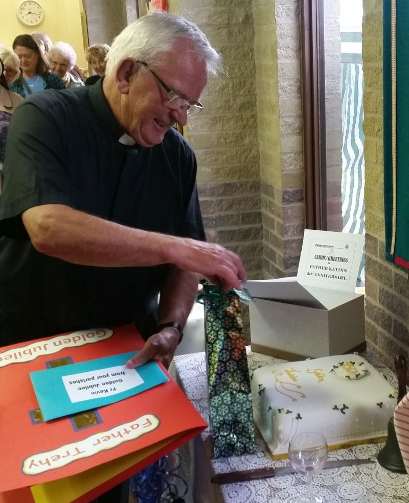Fr Kevin received a book made by children at St Wilfrid's RC Primary School